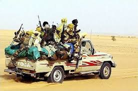 Charging across the desert near the Chad-Libya border