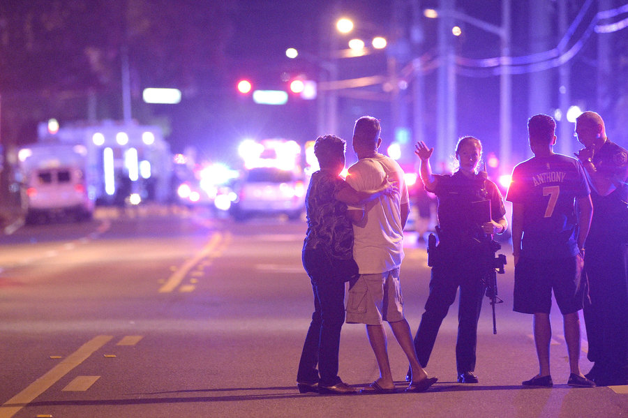 Police direct family members away from the Pulse nightclub. (AP photo)