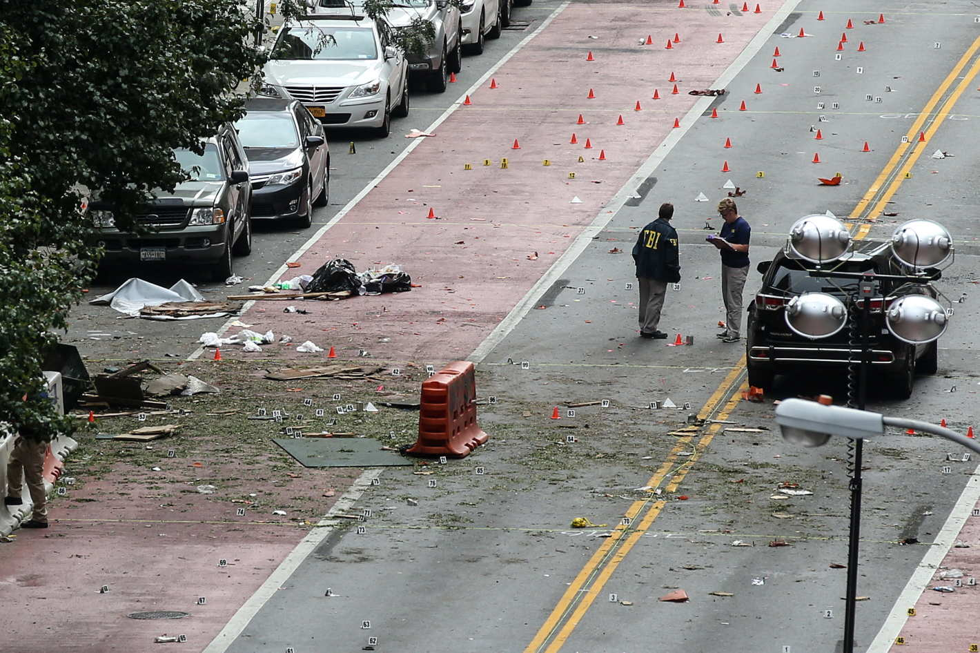Investigators at the scene of this weekend's explosion in New York City.
