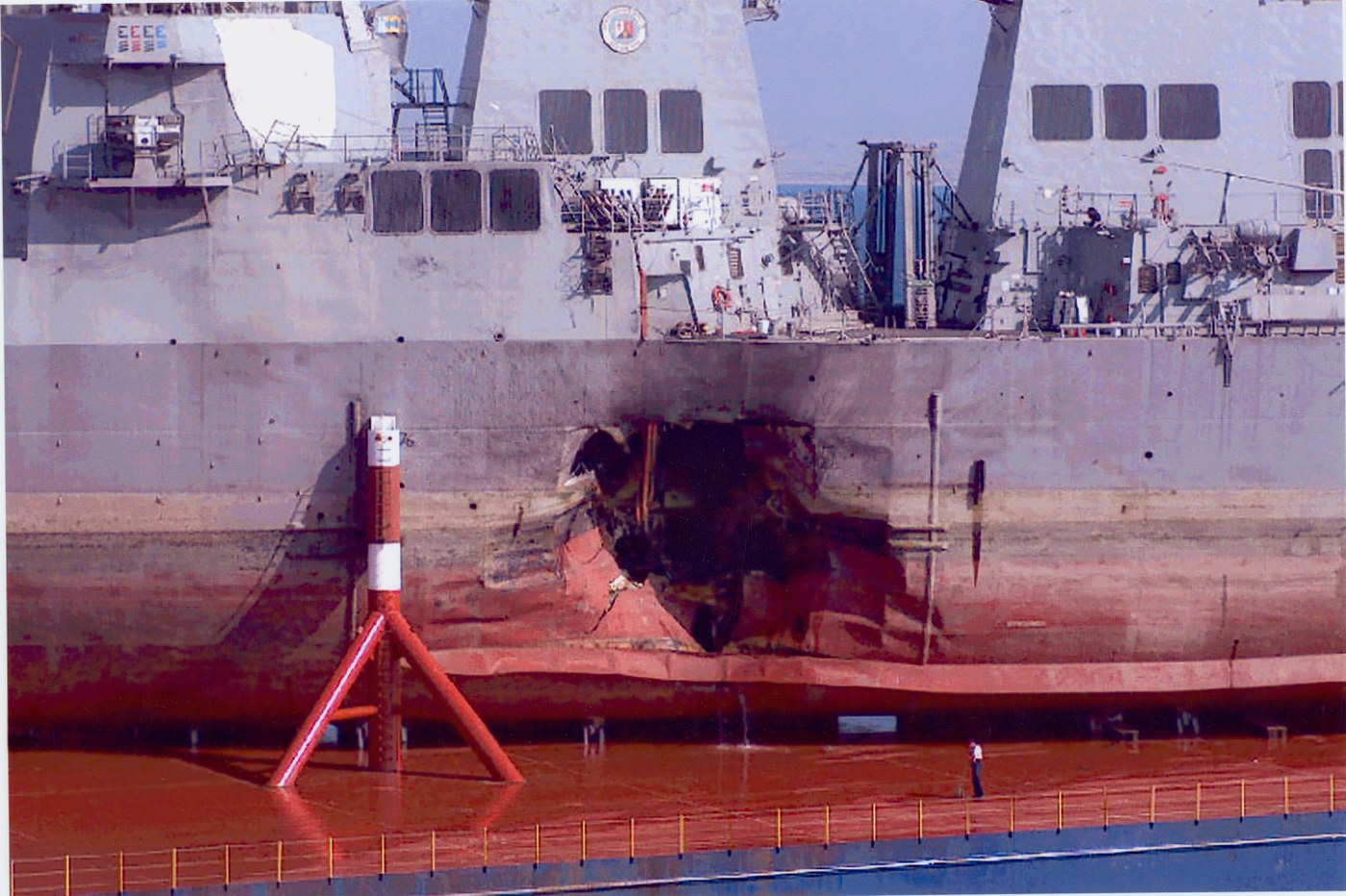 FBI photo of the damaged hull of the USS Cole.