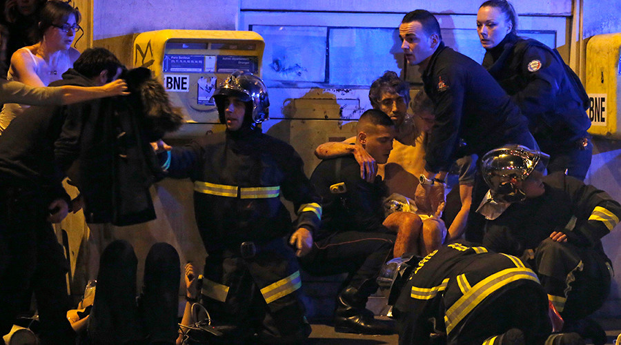 French fire brigade members tend to victims of the terrorist attack on the Bataclan theater in Paris, Nov. 13, 2015.