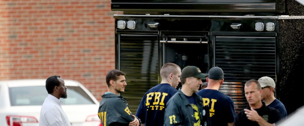 FBI investigators at the scene of a mosque bombing in Minnesota.