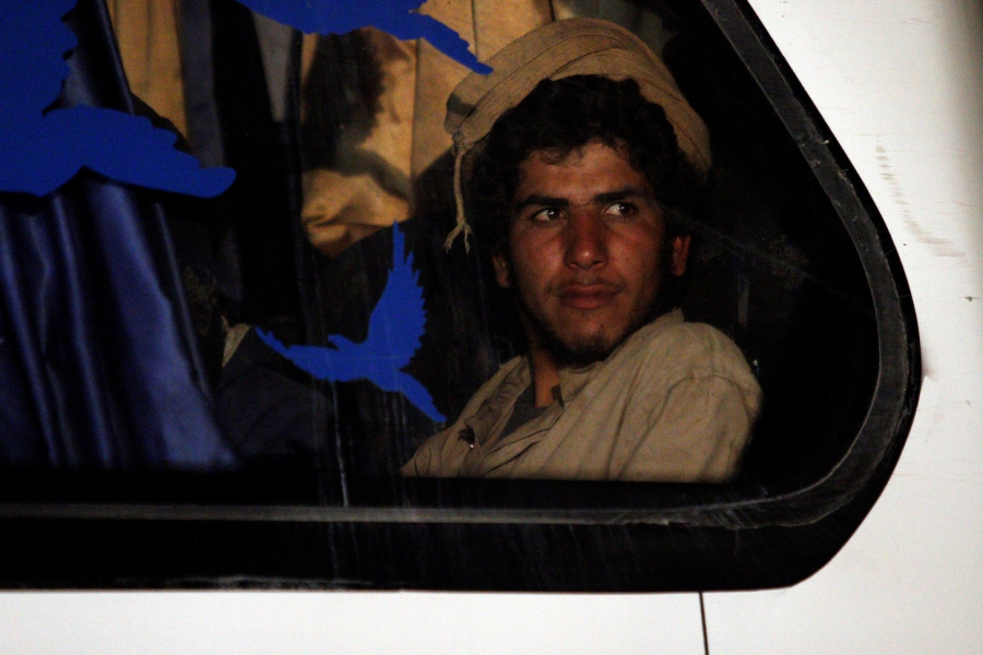 An ISIS fighter on the bus to safety. (Photo: PRI)