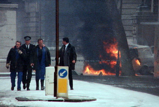 A van burns after it was used by the IRA to launch the 1991 mortar attack on 10 Downing Street, London, the official residence of the British prime minister.